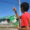 Child flying a kite, Tonga. Credit Pedram Pirnia