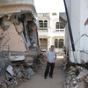 New Zealand Aid Programme staff member amongst damage caused by the earthquake, Indonesia, Oct 2009. Credit: New Zealand Ministry of Foreign Affairs and Trade