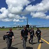 NZMAT personnel arriving off C-130 relief flight (2 March)