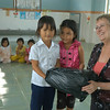 Little girls present a New Zealand Aid Programme staff member with a gift at an Early Childhood Education Centre in Binh Dinh, Vietnam, 2009. Credit: New Zealand Ministry of Foreign Affairs and Trade