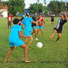 Fijian children playing rugby. Credit Pedram Pirnia