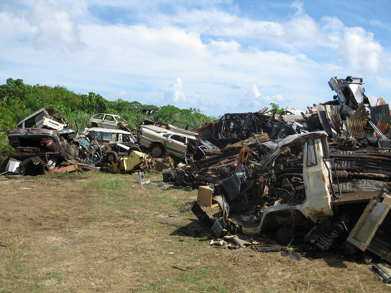 """Old cars are collected as part of  """"Operation Clean Up"""" a Niue Government  inititaive to improve the  environment and promote itself as a niche tourist destination, Niue, 2010. Credit: New Zealand Ministry of Foreign Affairs and Trade"""