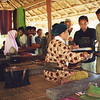 Women weavers from the Lombok Craft project are observed by visitors. Credit: New Zealand Ministry of Foreign Affairs and Trade
