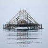 A fishing house along the Sunda Strait floats in the early morning near Ujung Kulon National Park, West Java. <br /> <br /> Photo by Hannah Taylor