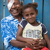Henry and his grandaughter Jenny. Henry has been treated by the visiting eye team at Kirakira Hospital, Solomon Islands. Credit: Kristian Frires, Fred Hollows