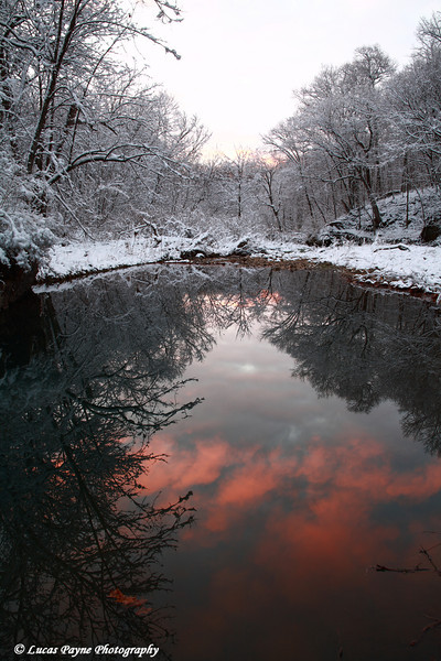 Colorful clouds reflected in Bear Creek at Bixby State Preserve near Edgewood in Northeast Iowa