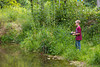 Boy fishing in Bear Creek at Bixby State Preserve near Edgewood in Northeast Iowa<br /> <br /> July 11, 2012