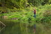 Boy fishing in Bear Creek at Bixby State Preserve near Edgewood in Northeast Iowa<br /> <br /> <br /> July 11, 2012