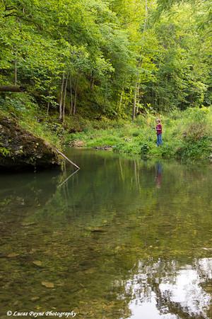 Boy fishing in Bear Creek at Bixby State Preserve near Edgewood in Northeast Iowa<br /> <br /> <br /> July 11, 2012