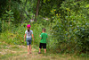 Young boy and girl walking to the Ice Cave at Bixby State Preserve near Edgewood in Northeast Iowa<br /> <br /> July 11, 2012