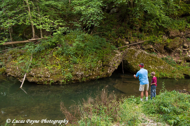 Father and son fishing in Bear Creek at Bixby State Preserve near Edgewood in Northeast Iowa<br /> <br /> July 11, 2012