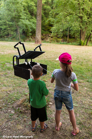Two kids roasting marshmallows at Bixby State Preserve near Edgewood in Northeast Iowa<br /> <br /> July 11, 2012