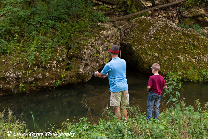 Father and son fishing in Bear Creek at Bixby State Preserve near Edgewood in Northeast Iowa<br /> <br /> <br /> July 11, 2012