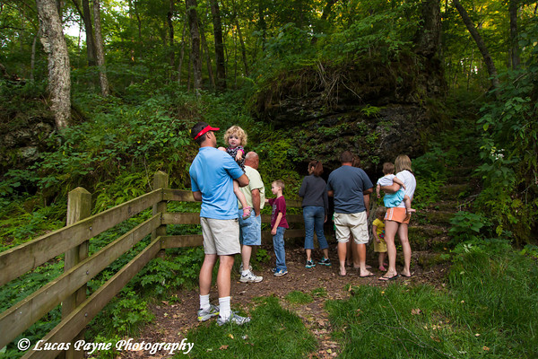 Family looking at the Ice Cave in Bixby State Preserve near Edgewood in Northeast Iowa<br /> <br /> July 11, 2012