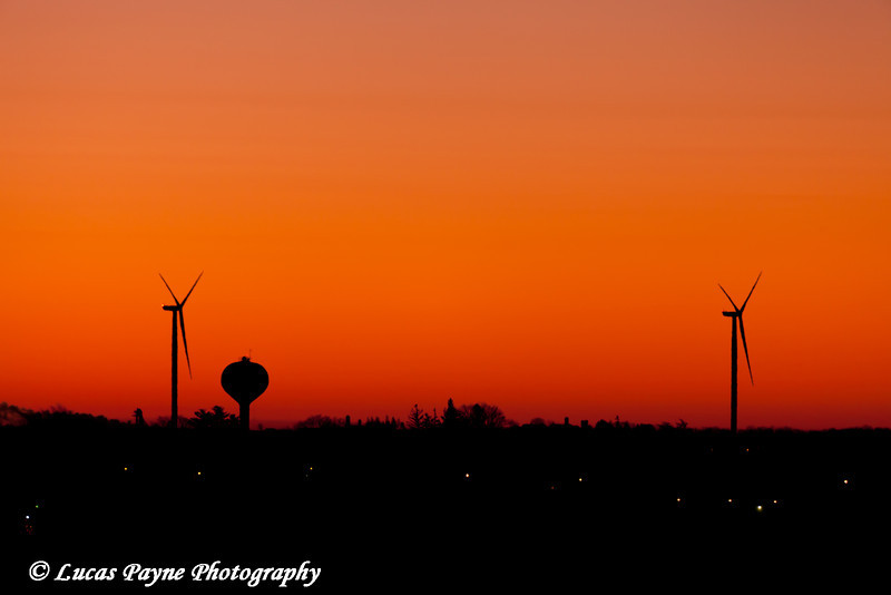 Edgewood water tower and wind turbines from the Elk Wind Energy Farm at sunrise in Northeast Iowa<br /> December 26, 2011