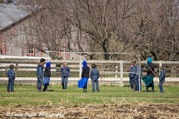 Amish school children playing volleyball near Hazelton, Iowa.<br /> April 08, 2010