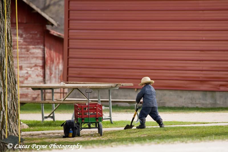 Amish boy playing near Hazelton, Iowa.<br /> April 10, 2010