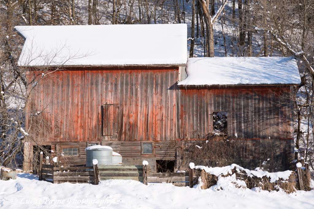 Old red barn covered in fresh snow near Elkader in Northeast Iowa<br /> <br /> December 27, 2012