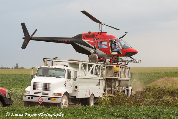 Crop dusting helicopter landed on top of tank truck refilling for another flight, Northeast Iowa<br /> <br /> July 12, 2012