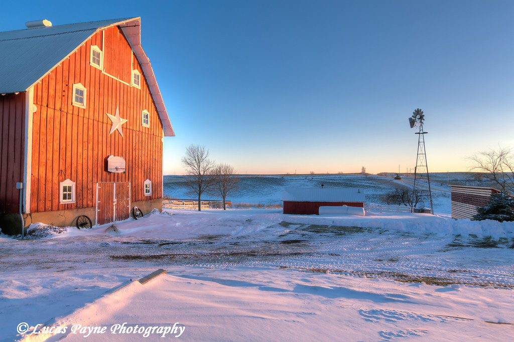 Red barn with fresh snow at sunset on a farm near Edgewood in Northeast Iowa<br /> <br /> December 21, 2012