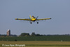 Crop duster spraying a corn field in Eastern Iowa<br /> <br /> July 10, 2012