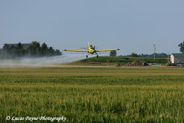 Crop duster spraying a corn field in Eastern Iowa<br /> <br /> July 10, 2012