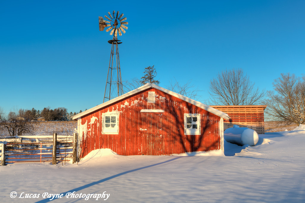 Red hog house and a windmill with fresh snow on a farm near Edgewood in Northeast Iowa<br /> <br /> December 21, 2012