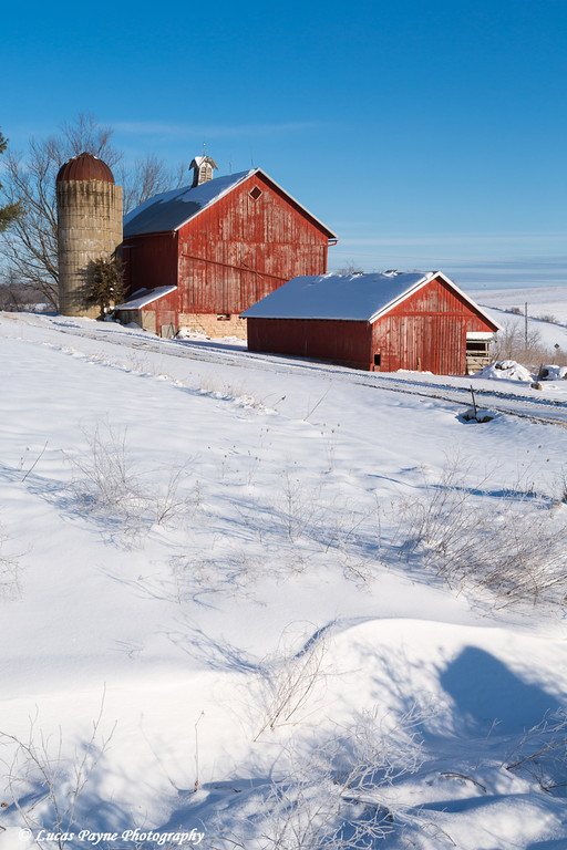 Red farm buildings after a fresh snowfall on a sunny day near Elkader in Northeast Iowa<br /> <br /> December 27, 2012