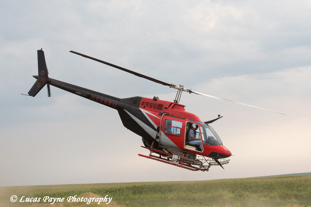 Crop dusting helicopter taking off from refilling for another flight, Northeast Iowa<br /> <br /> July 12, 2012