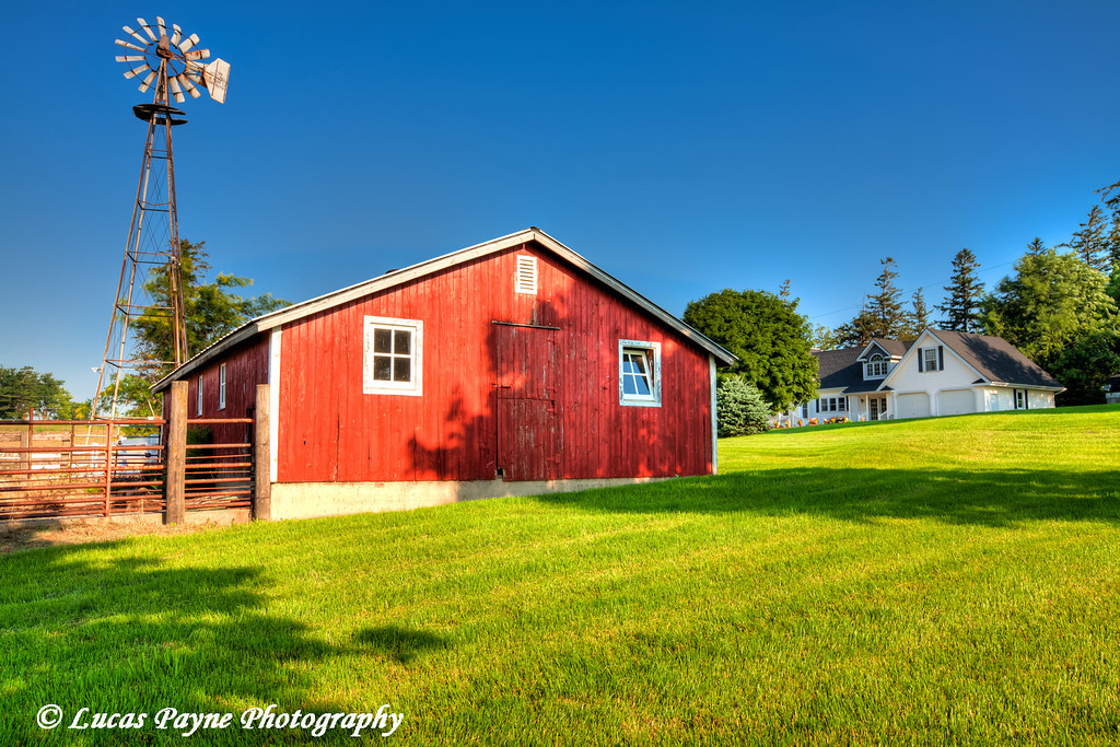 Farm building and windmill in Northeast Iowa.<br /> June 30, 2011<br /> HDR