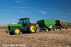 Farmer hooking up two grain wagons full of soybeans to a tractor in Northeast Iowa.<br /> <br /> October 27, 2013