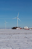 Wind turbines from the Elk Wind Energy Farm rising above a farm and the snow covered landscape near Greeley in Northeast Iowa<br /> <br /> December 25, 2012