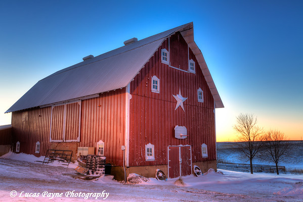 Red barn with fresh snow at sunrise on a farm near Edgewood in Northeast Iowa<br /> <br /> December 21, 2012