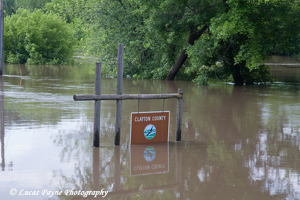 A Clayton County park sign under water in Elkader, Iowa.