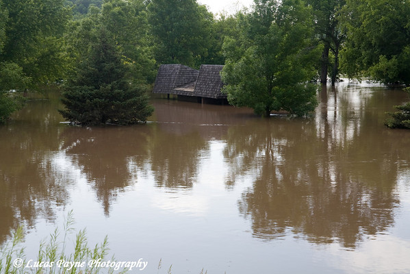 An Elkader park shelter under water.