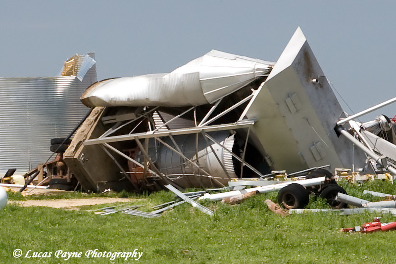 Cropped image of the previous photo. Notice the concrete pad ripped out of the ground from the tornado. Cropped for a closer look.