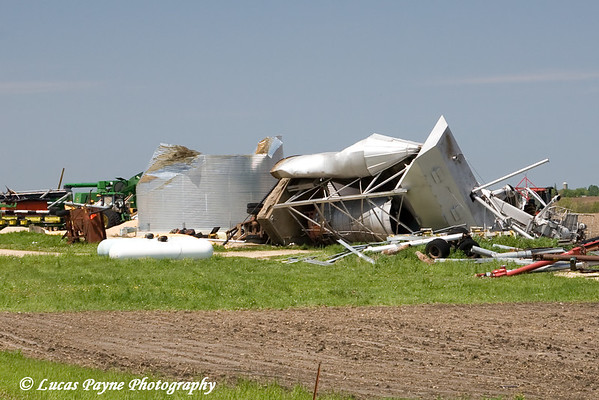 Cropped image of the previous photo. Notice the concrete pad ripped out of the ground from the tornado.