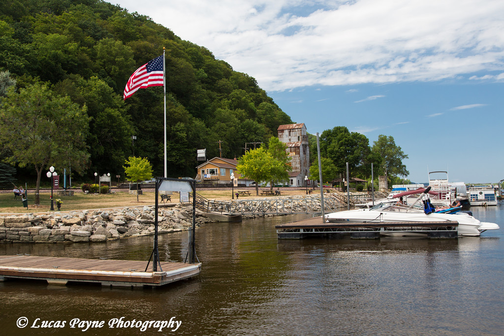 Boats docked with the American Flag flying in McGregor, Iowa<br /> <br /> July 08, 2012