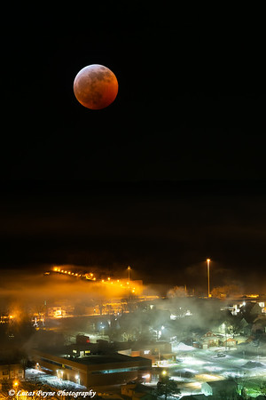 In-camera Double Exposure of the 2019 Lunar Eclipse Super Blood Moon over Lock and Dam No. 10 on the Mississippi River in Guttenberg, Iowa<br /> <br /> January 20, 2019