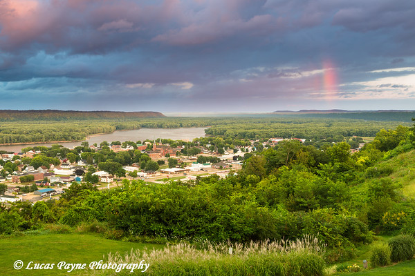 Colorful clouds and a rainbow at sunset over Guttenberg, Iowa and the Mississippi River<br /> <br /> August 17, 2017