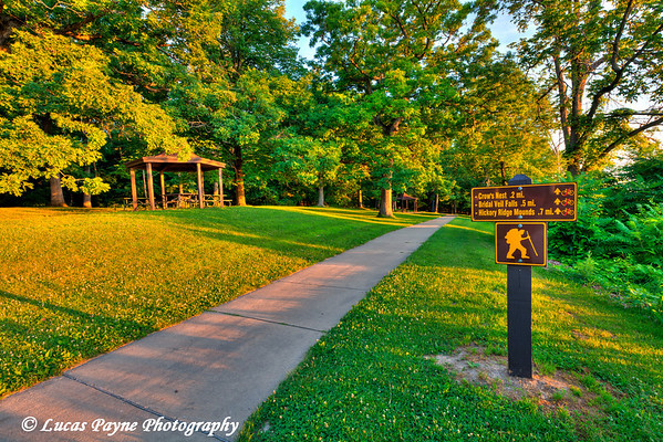 Hiking distance sign along a trail at Pikes Peak State Park in Northeast Iowa.<br /> July 05, 2011<br /> HDR