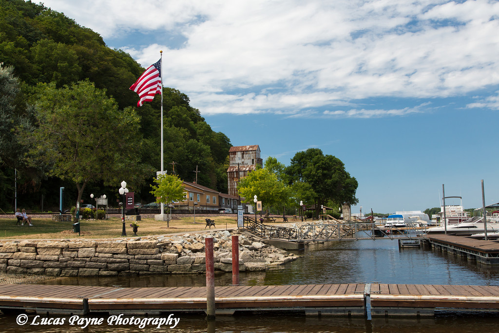 Boat dock with the American Flag flying in McGregor, Iowa<br /> <br /> July 08, 2012