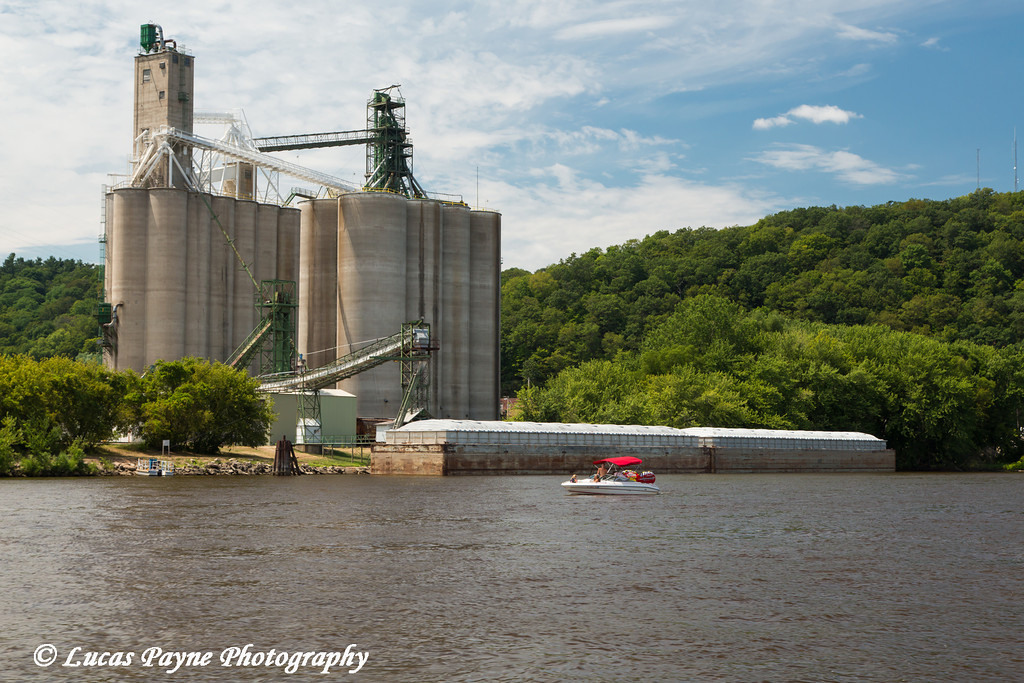 Grain storage and a barge along the Mississippi River in McGregor, Iowa<br /> <br /> July 07, 2012