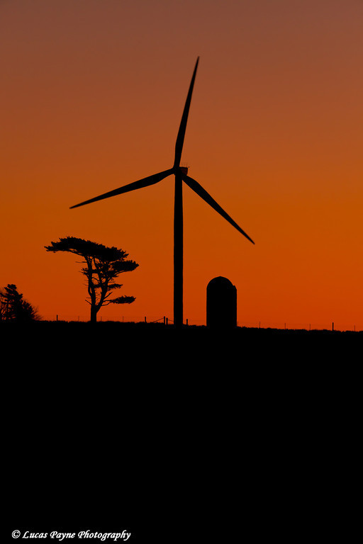 Elk Wind Energy Farm wind turbine and silo at sunrise near Edgewood in Eastern Iowa<br /> December 25, 2011