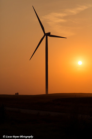 Silhouette of a wind turbine from the Elk Wind Energy Farm at sunset near Edgewood in Northeast Iowa<br /> <br /> July 05, 2012