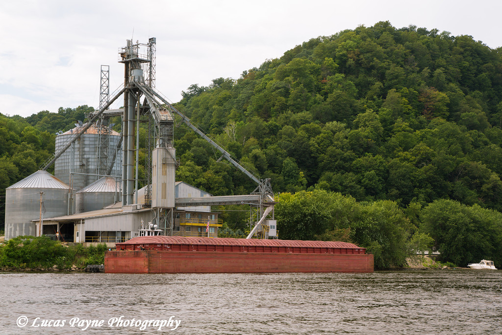 Barge docked at a grain terminal along the Mississippi River in McGregor Iowa<br /> <br /> July 07, 2012