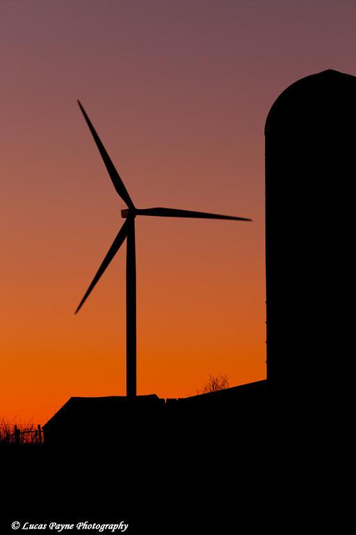 Elk Wind Energy Farm and a silo at sunrise near Edgewood in Eastern Iowa<br /> December 25, 2011
