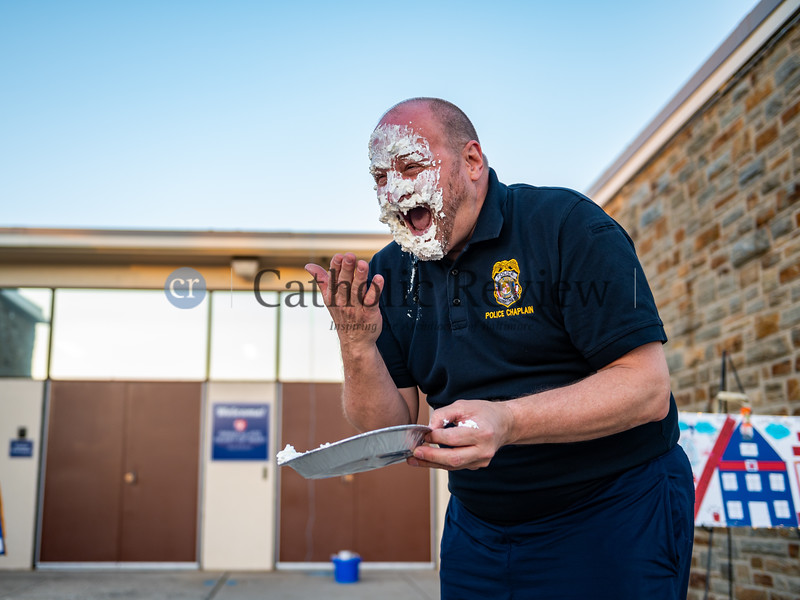 """Father Jeffrey Dauses, pastor of Immaculate Heart of Mary Catholic Church in Baynesville, makes good on his promise of getting a pie in the face after meeting his $2500 goal during his Nov. 20 """"Fool on the School"""" fundraiser. (Kevin J. Parks/CR Staff)"""