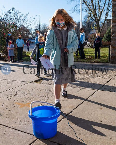 """Students from Immaculate Heart of Mary Catholic School in Baynesville make a donation Nov. 20 to Father Jeffrey Dauses and his """"Fool on the School"""" fundraiser. (Kevin J. Parks/CR Staff)"""