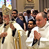 His Eminence Sean Patrick Cardinal O'Malley,OFM Cap. Archbishop of Boston, makes his way into Immaculate Conception Parish in Lowell, for the Rite of Ordination to the Order of Deacon ceremony, walking past one of fourteen candidates for Deacon Mr. Brian Peter O'Hanlon on right. SUN/ David H. Brow